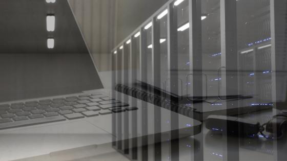 laptop-overlayed-with-data-center-racks